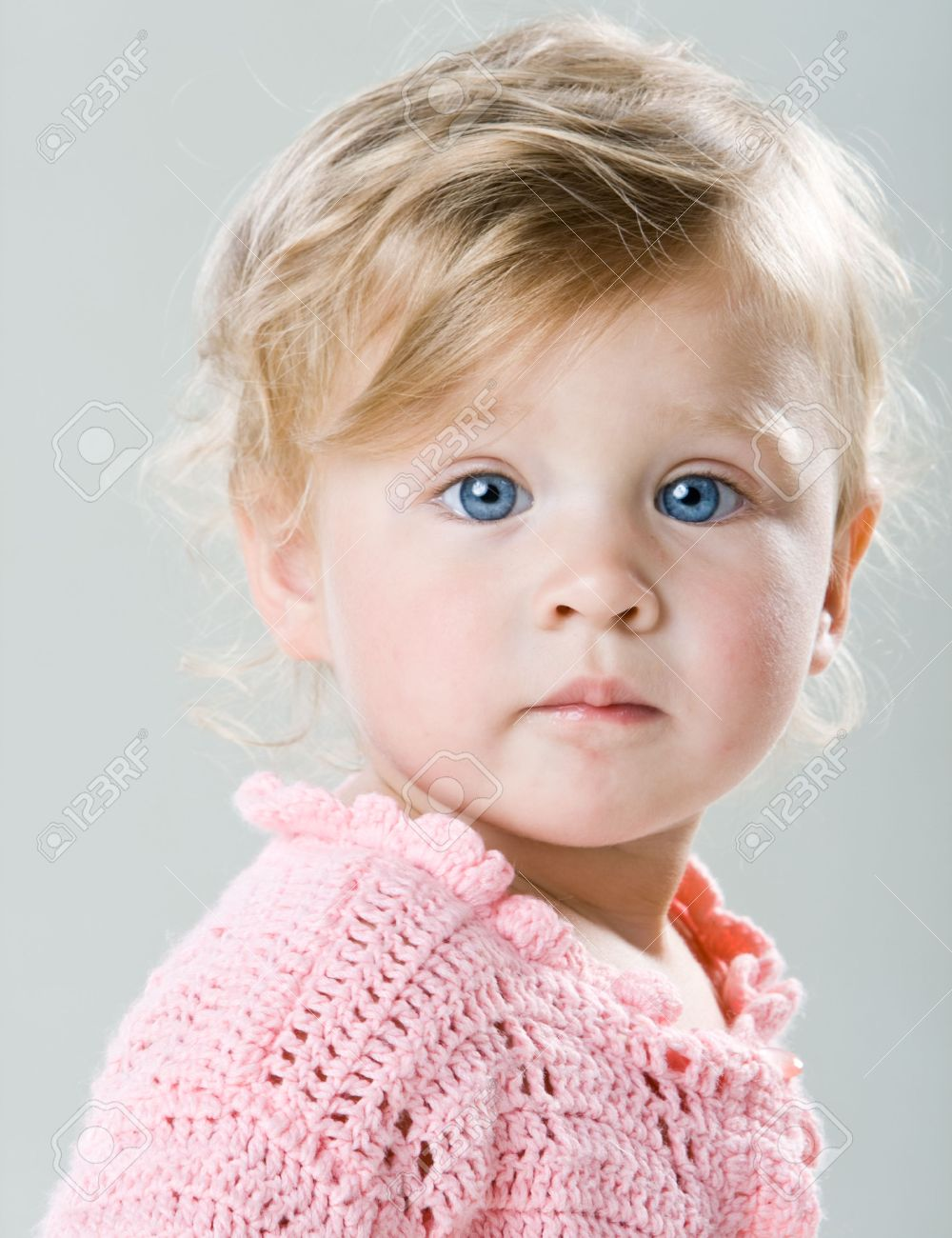 Portrait of beautiful little girl with big blue eyes closeup Stock Photo - 5749071