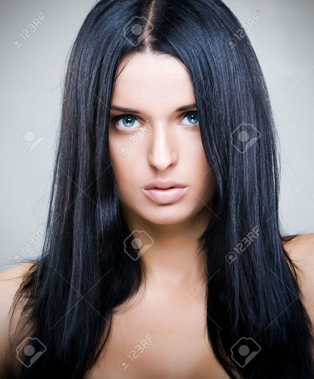 Fashion portrait of beautiful young woman with perfect black hair and full lips Stock Photo - 6246276