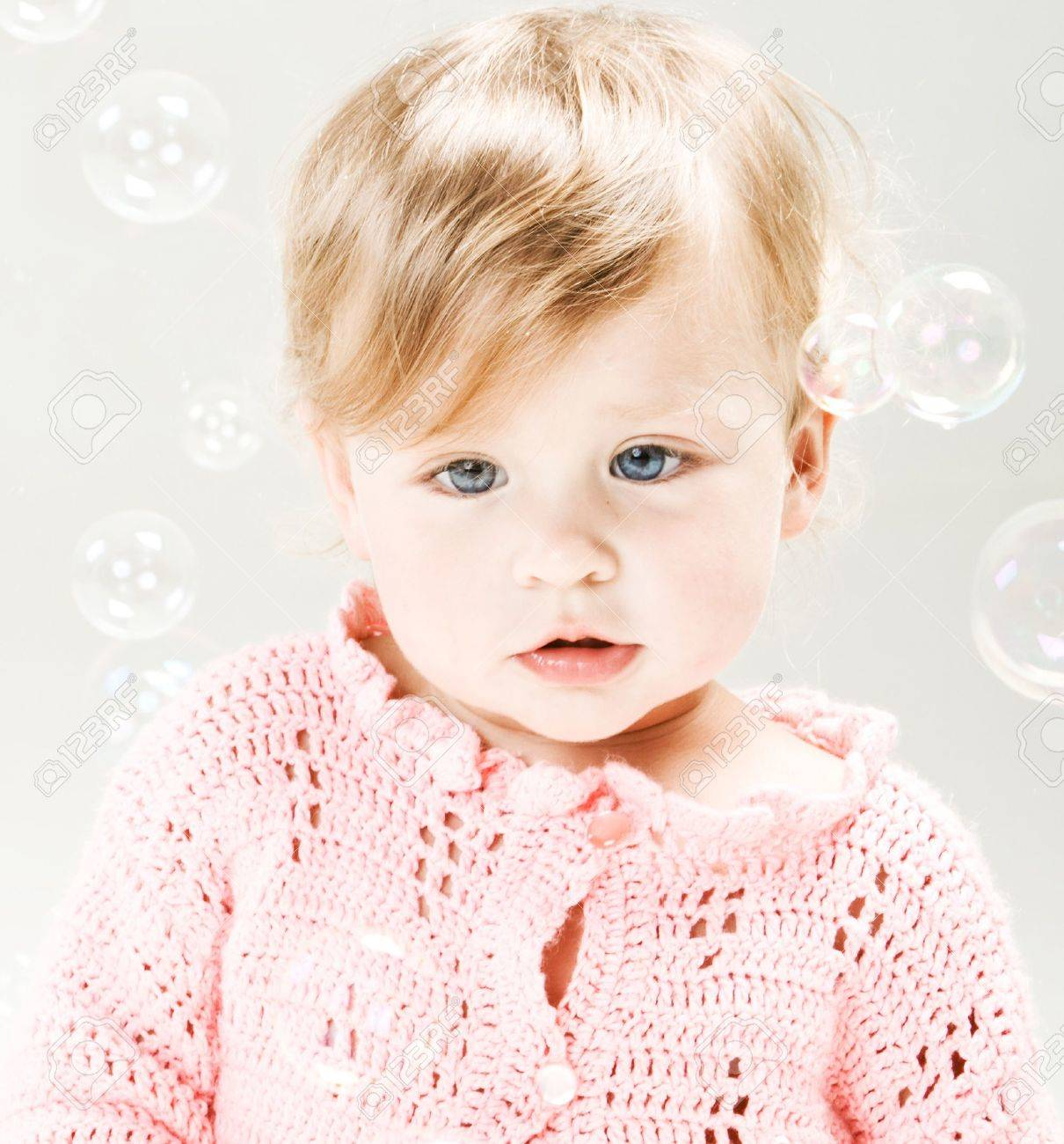 Portrait of very sweet little girl with soap bubbles - 6462745