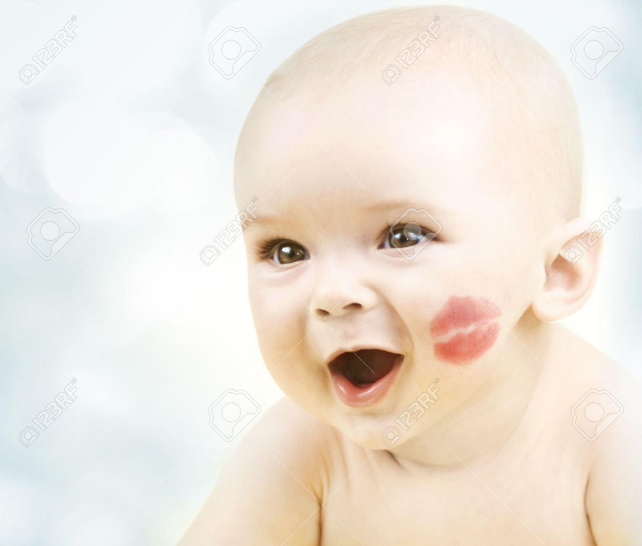 Happy smiling little baby with kiss - 7365285