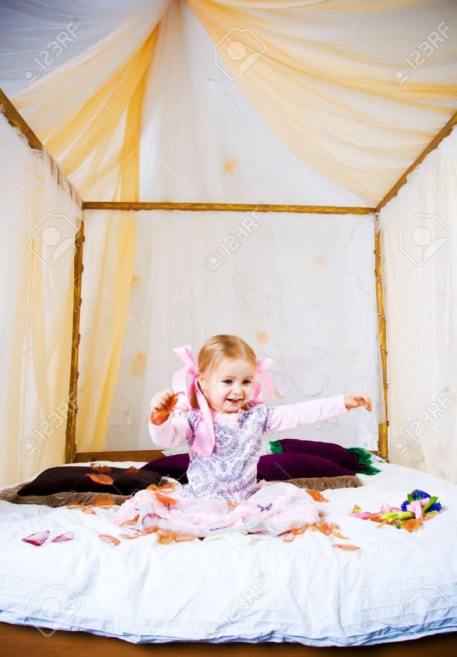 Beautiful little girl play on king bad Stock Photo - 8781922