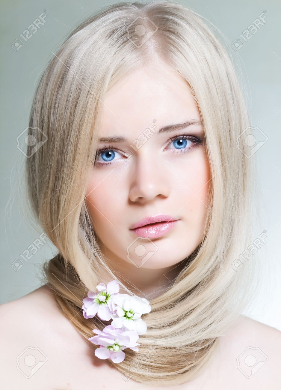 Beautiful young girl with white hair and blue eyes Stock Photo - 11034660