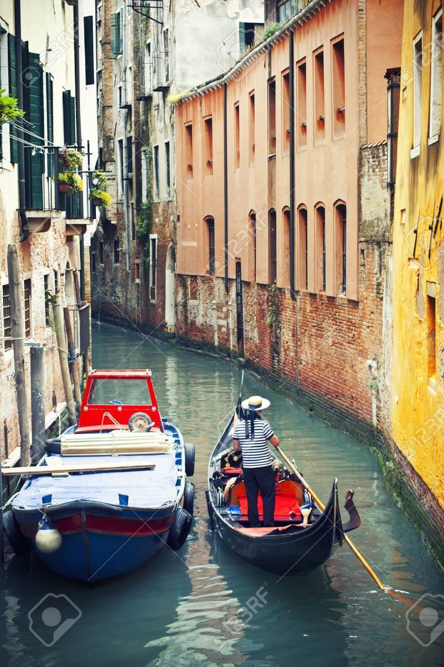 Gondolier in venetian canal, Venice, Italy - 36245698