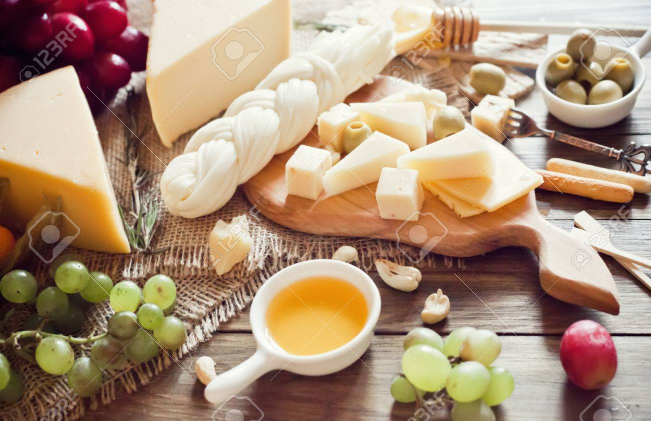 Cheese plate with various cheeses grape and honey Stock Photo - 57151969 & Cheese Plate With Various Cheeses Grape And Honey Stock Photo ...