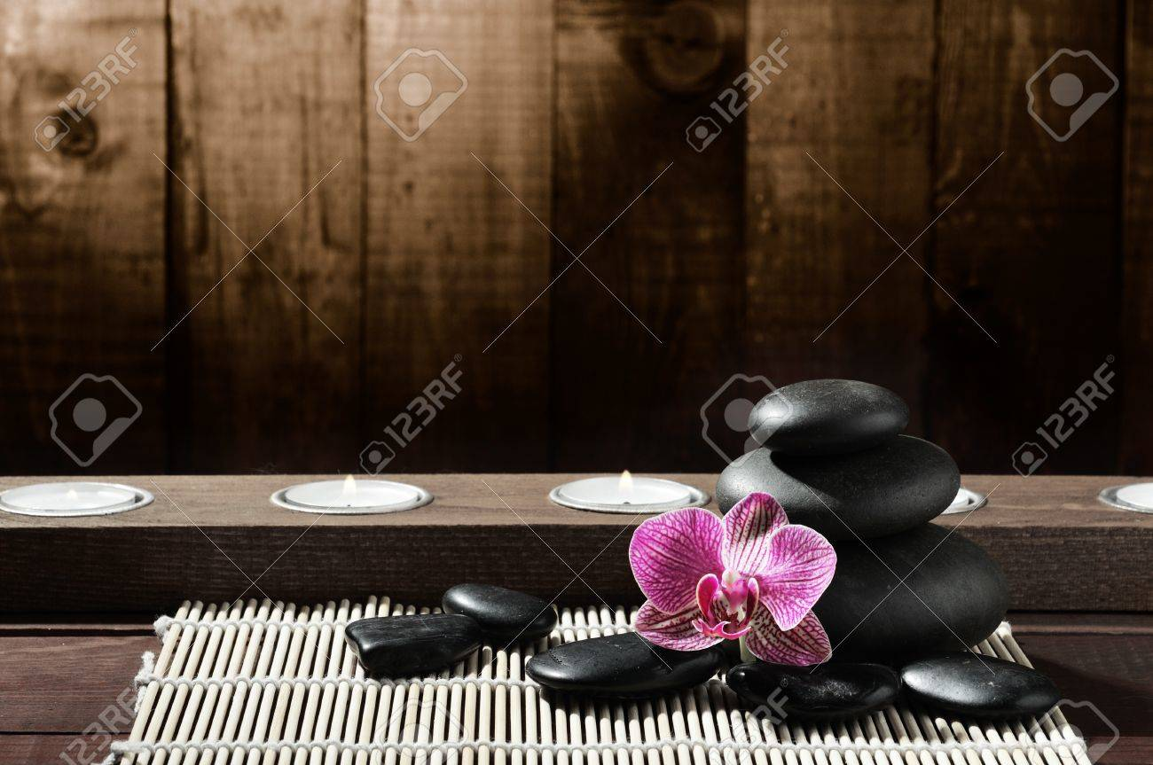 zen black stones and pink orchid Stock Photo - 8314995