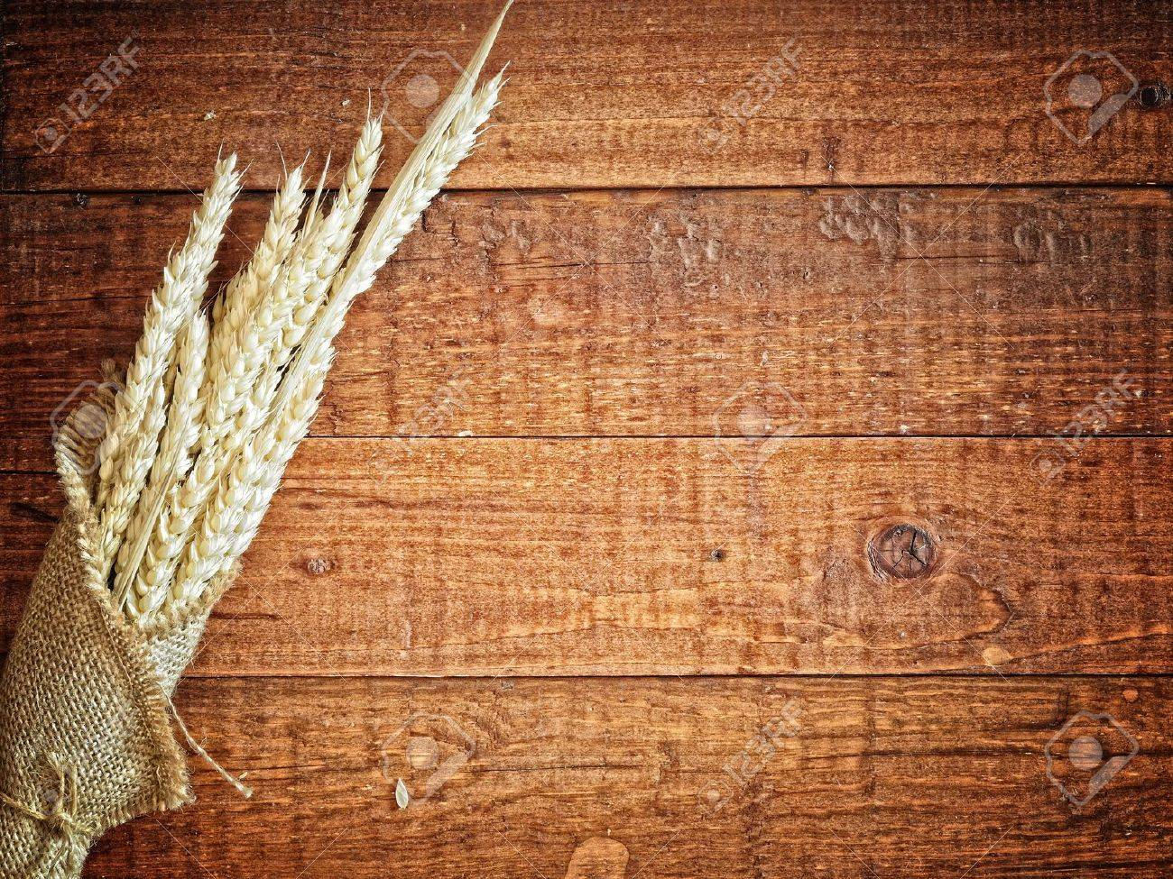 wheat in the mug  on the wooden background Stock Photo - 9484084