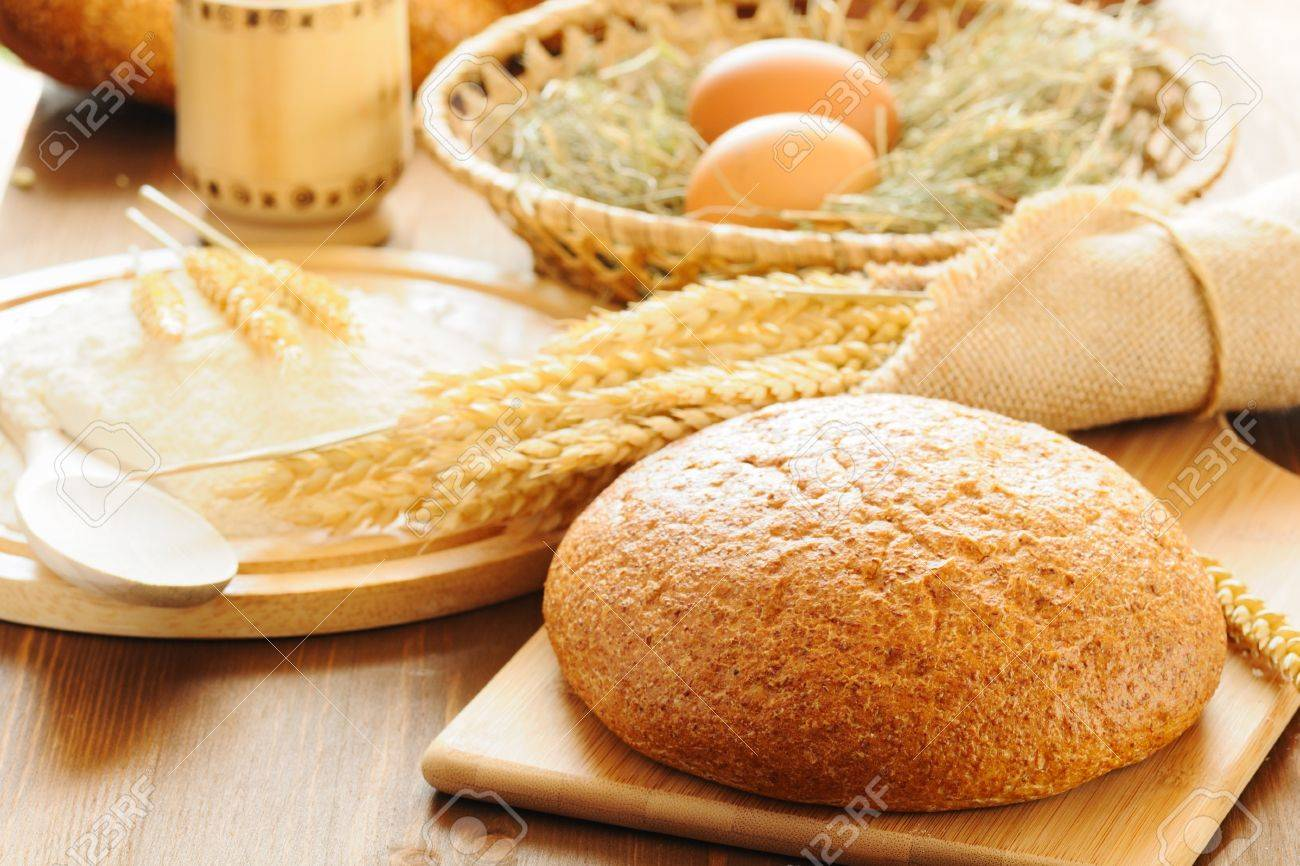 sliced bread and wheat on the wooden table Stock Photo - 9491244