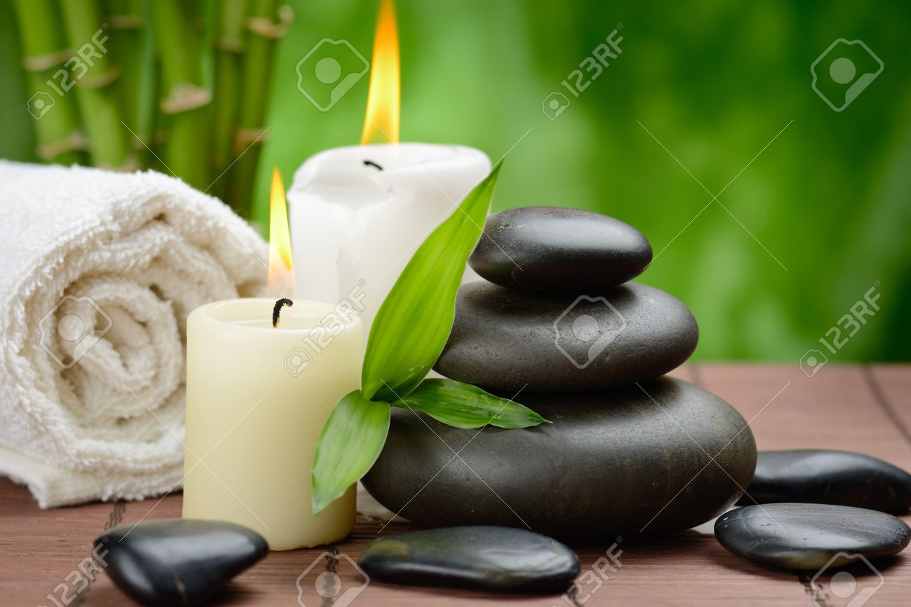 zen basalt stones and candle on the wooden mat Stock Photo - 15935904