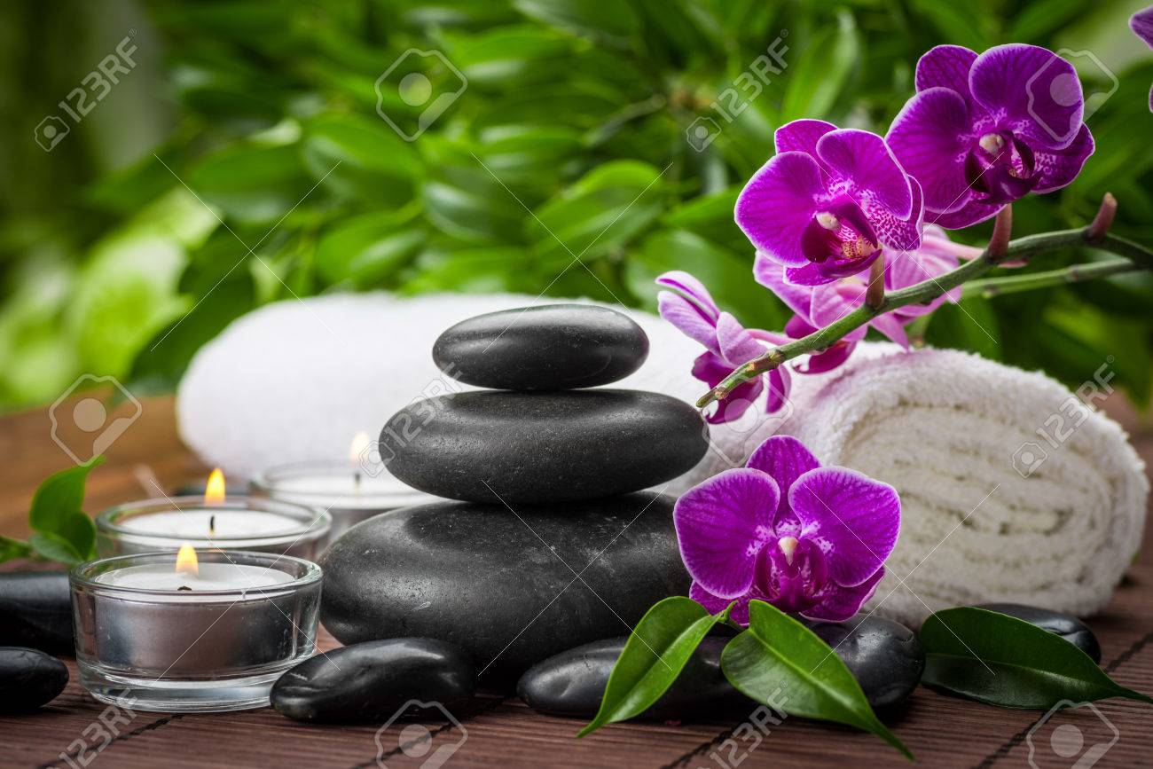 zen basalt stones and orchid on the wood Stock Photo - 22474377