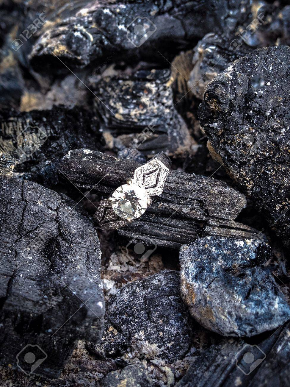 Diamond ring on coals and ash Stock Photo - 21986102