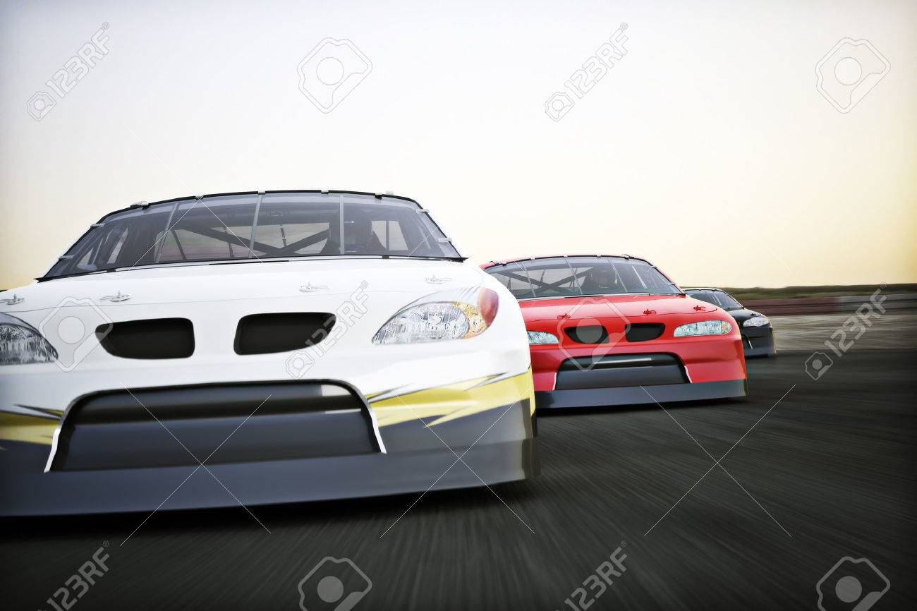Front view of auto racing race cars racing on a track with motion blur. Standard-Bild - 42121958