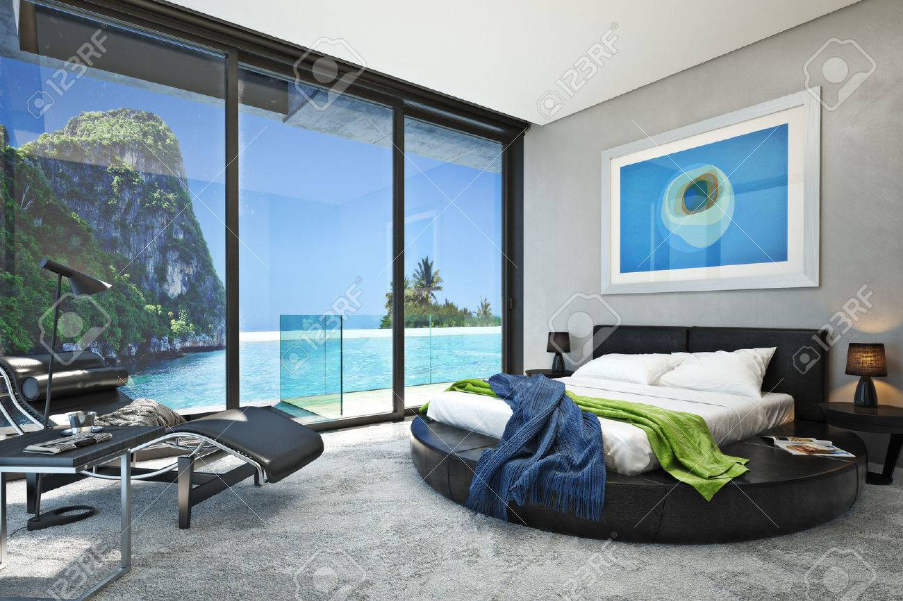 Modern bedroom with a view of a magnificent seaside ocean cove. Photo realistic 3d rendering. Standard-Bild - 47415153