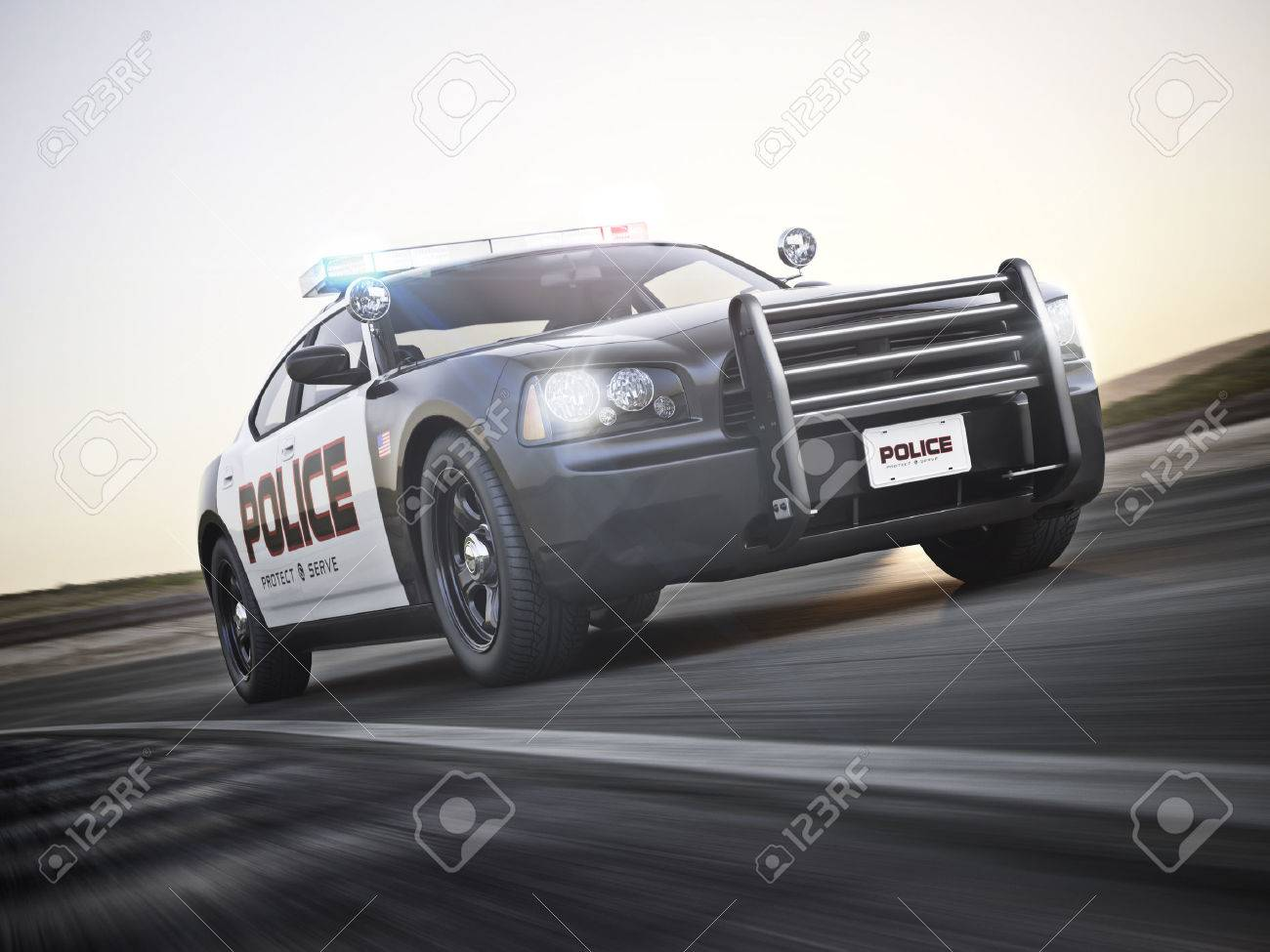 Police Car Running With Lights And Sirens On A Street With Motion