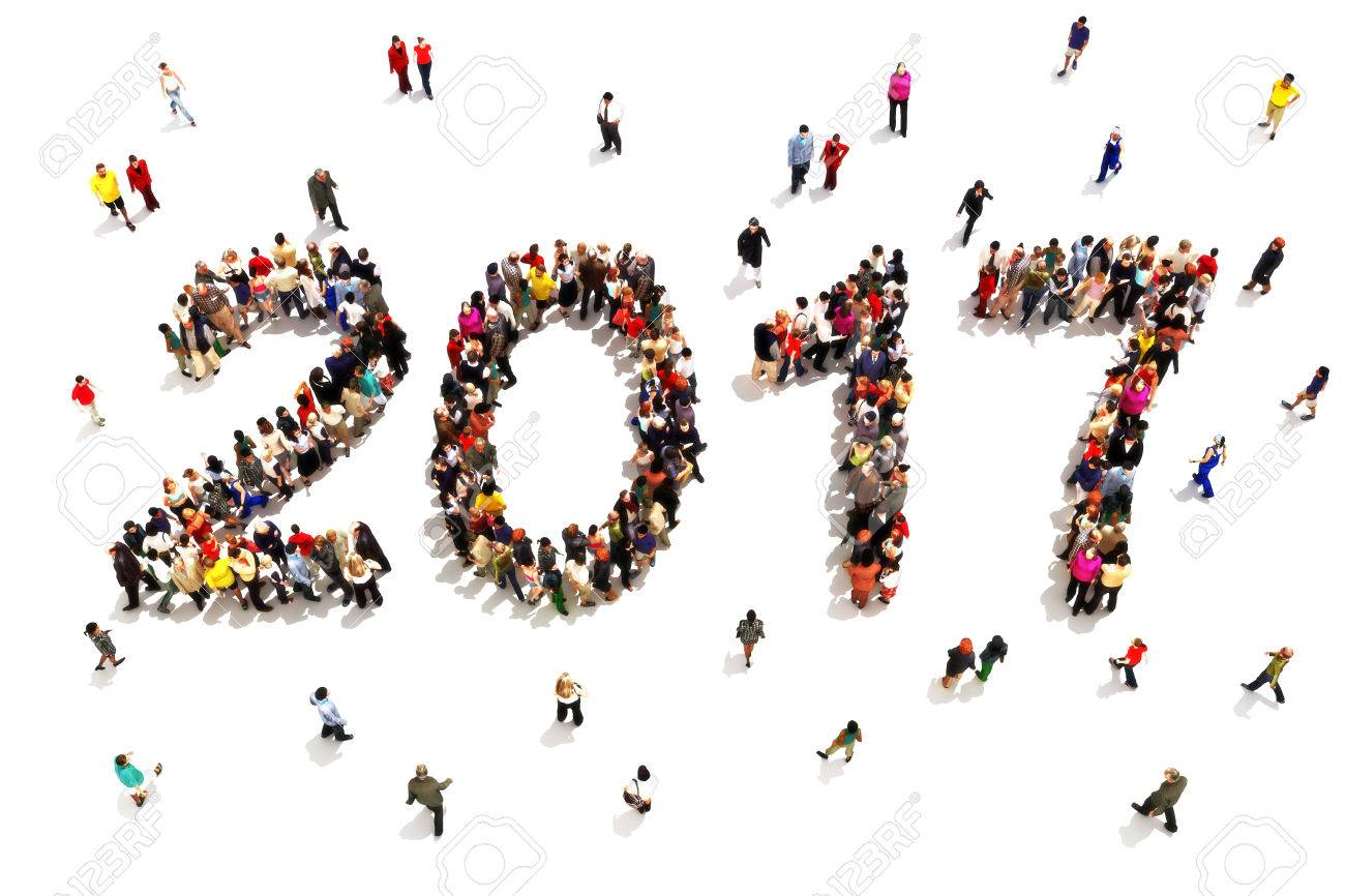 Bringing in the new year. Large group of people in the shape of 2017 celebrating a new year concept on a white background. Standard-Bild - 57417961