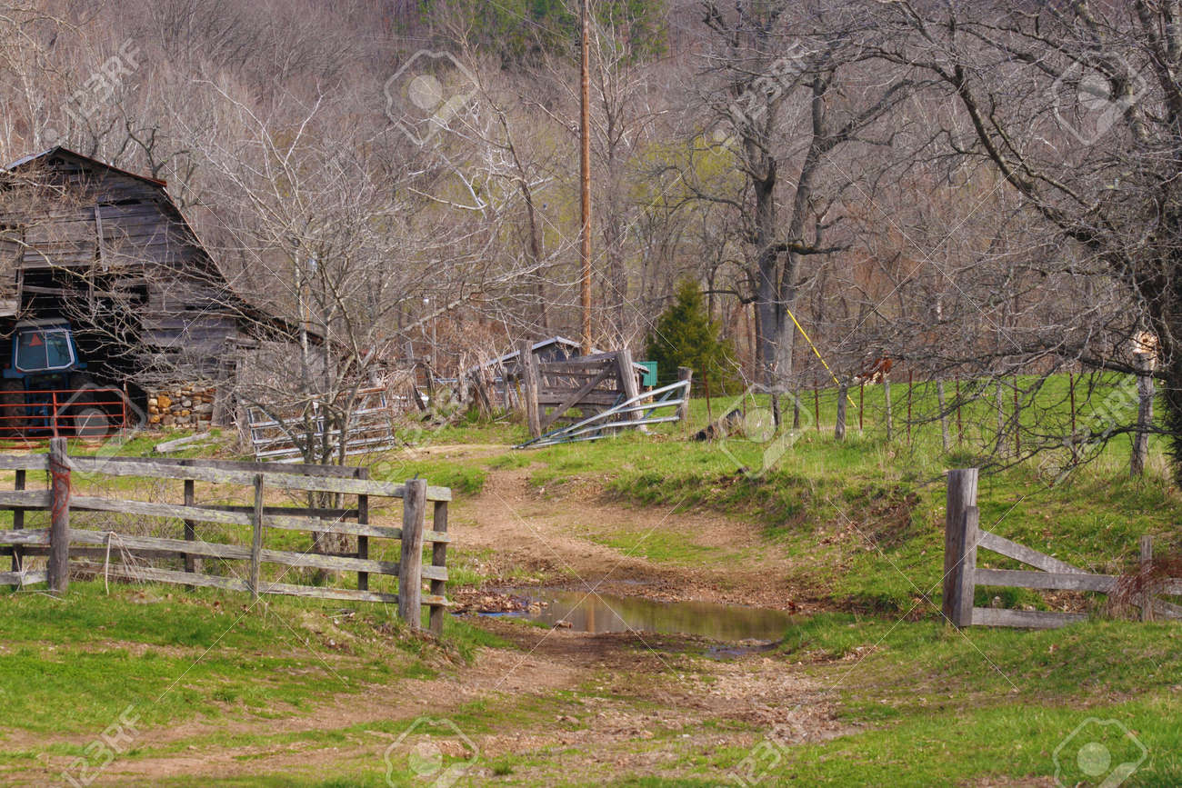 A Nice View Of An Old Barnyard With The Time Wooden Fence Stock Photo