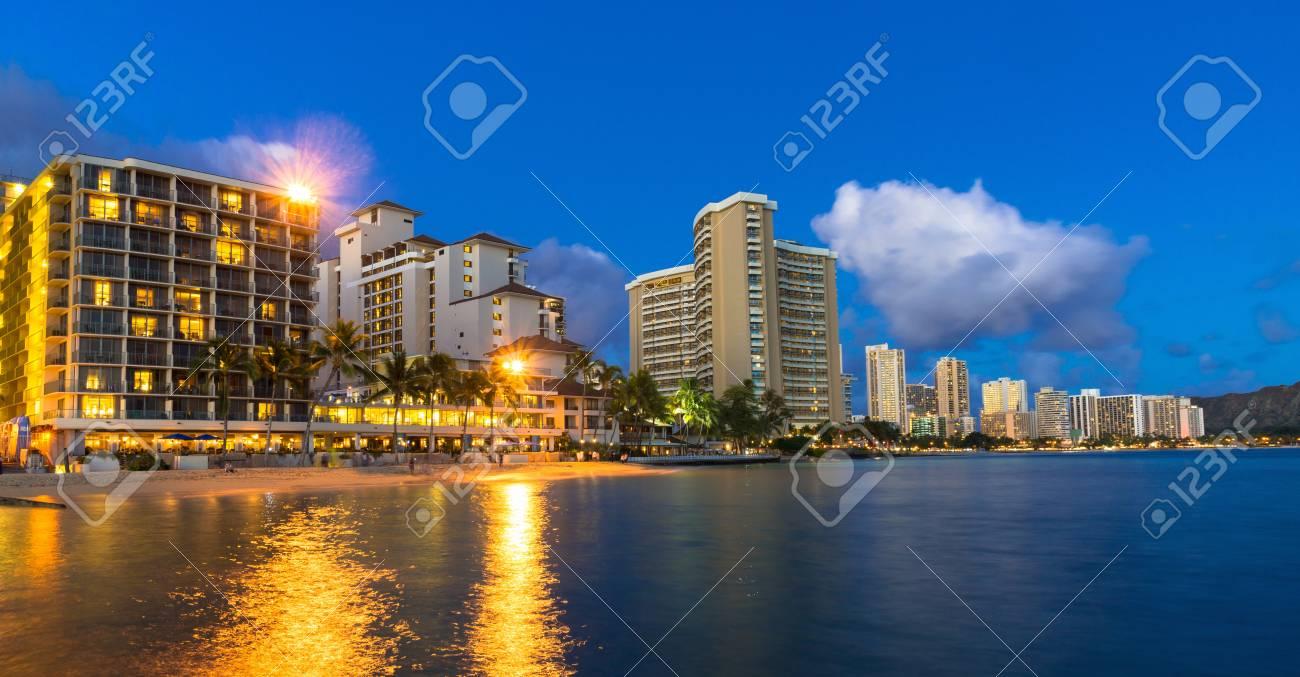 Beachfront Hotels On Waikiki Beach In Hawaii Against A Blue Night