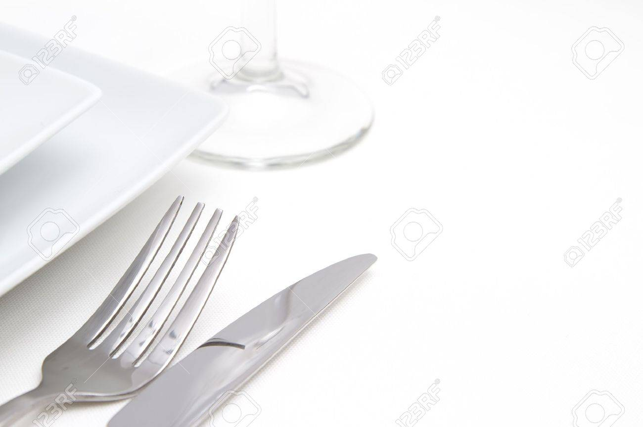 Dinner place setting white square china plates with silver cutlery and glass Stock Photo - 14355762  sc 1 st  123RF.com & Dinner Place Setting White Square China Plates With Silver Cutlery ...