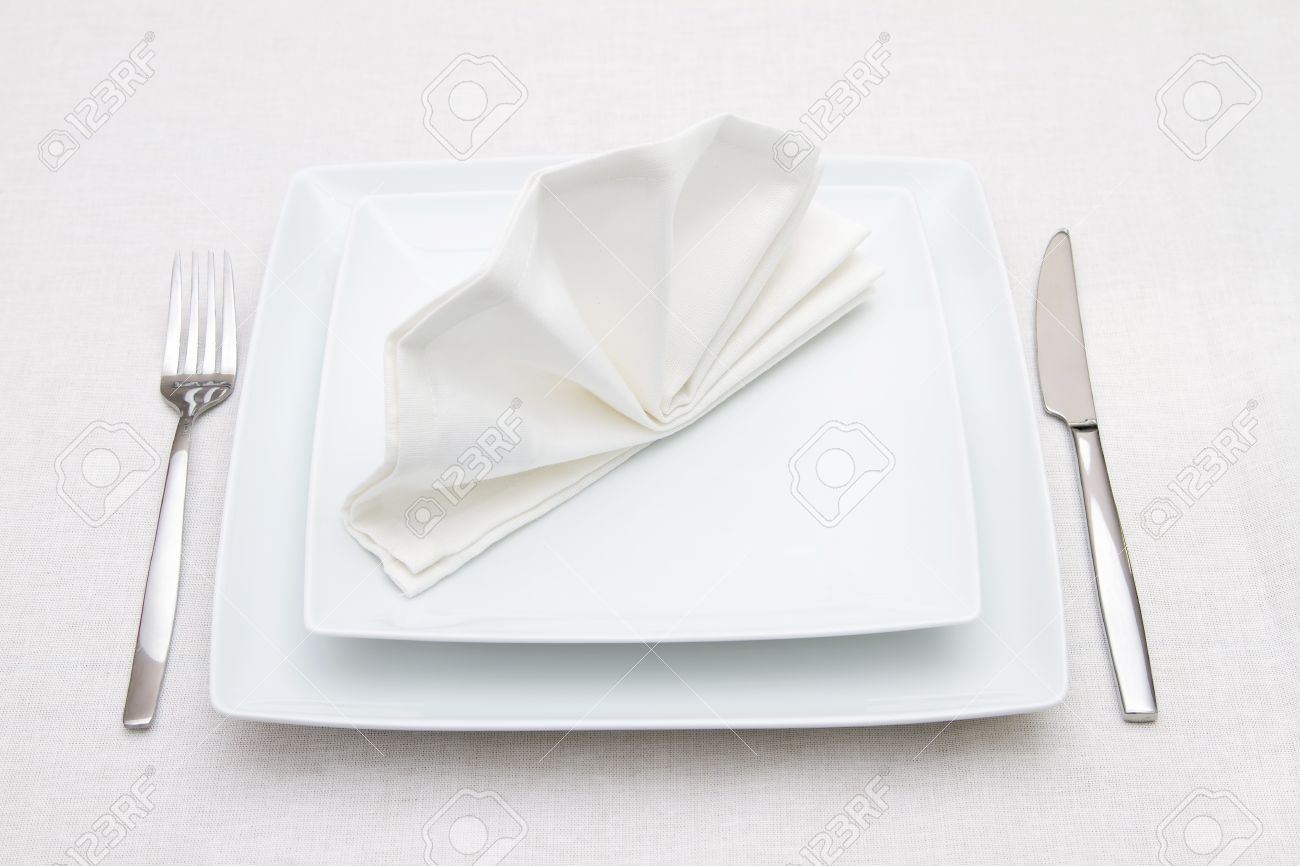Place setting with white plates and white folded napkin Stock Photo - 18512796 & Place Setting With White Plates And White Folded Napkin Stock Photo ...