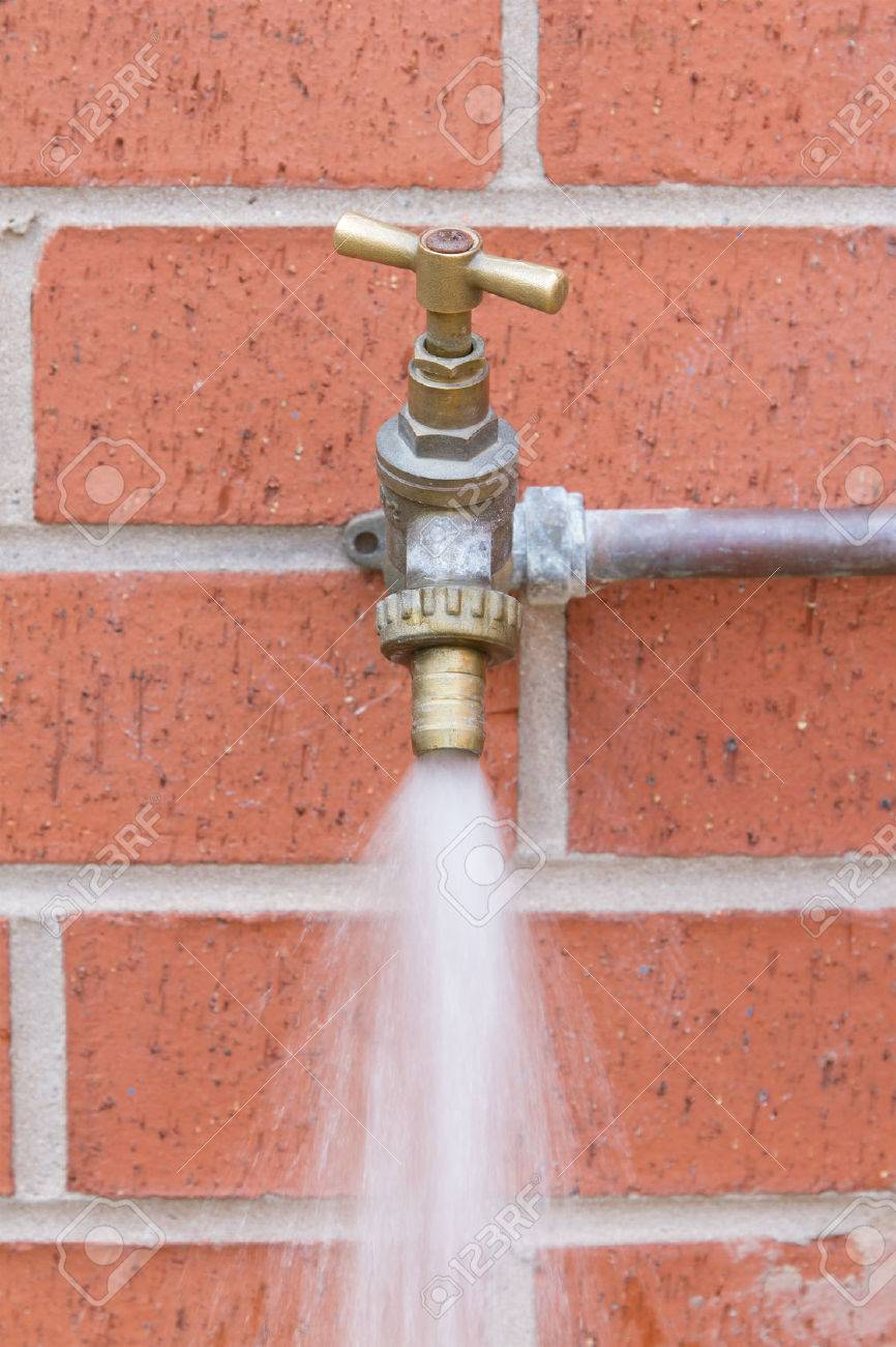 Outside Tap On Brick Wall Wasting Water Stock Photo   30154679