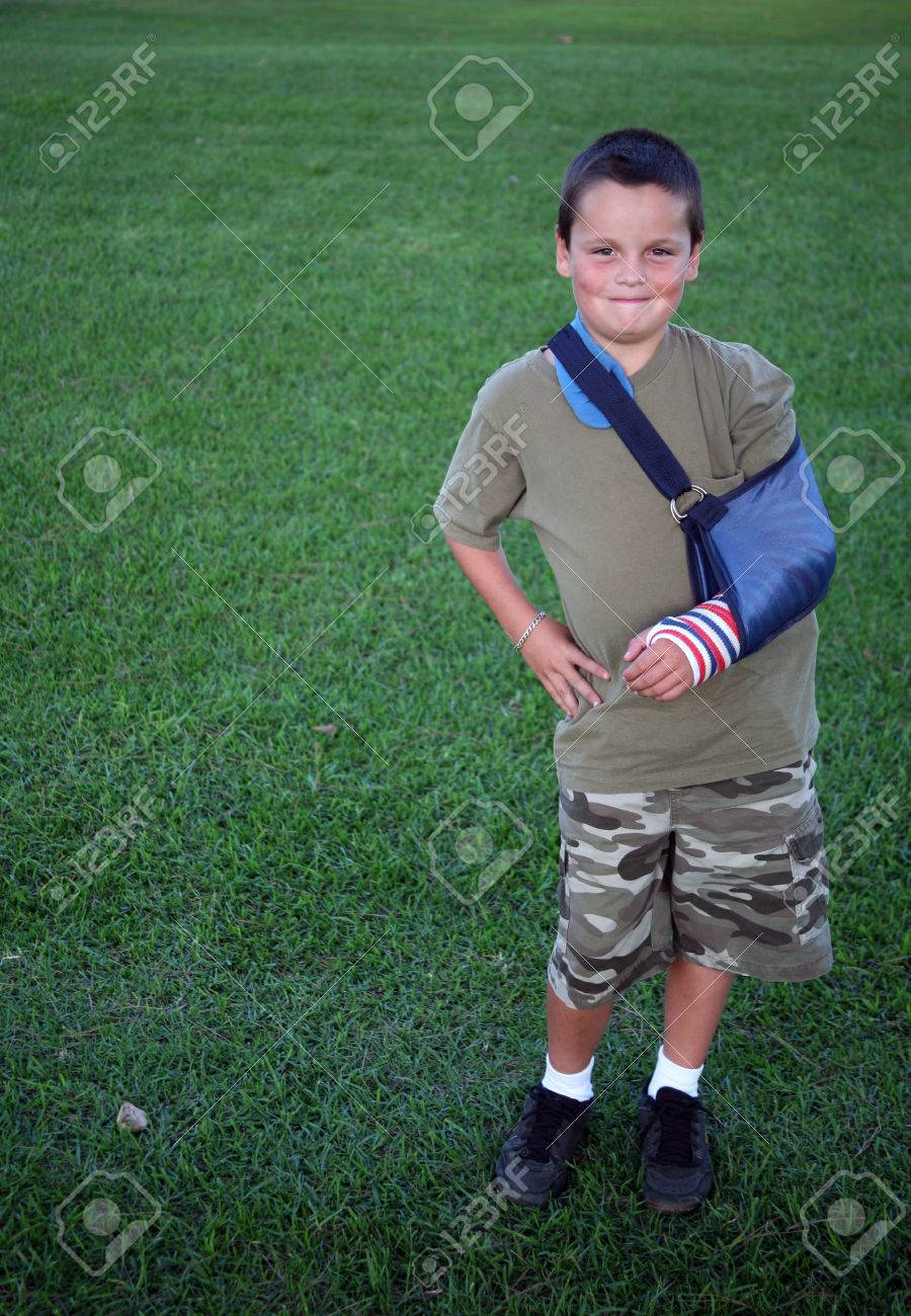 Colored cast - Young Boy Wearing A Patriotic Colored Cast Stock Photo 1718861