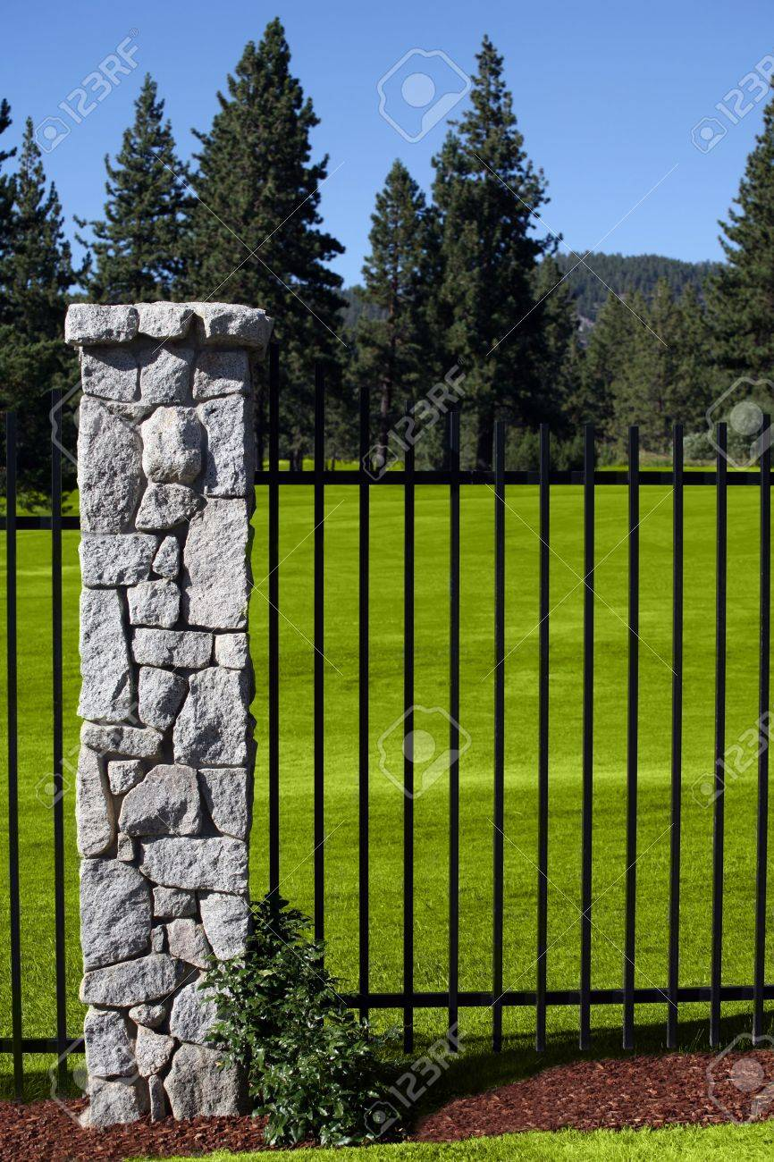 Lush golf course behind a wrought iron fence Stock Photo - 2309781
