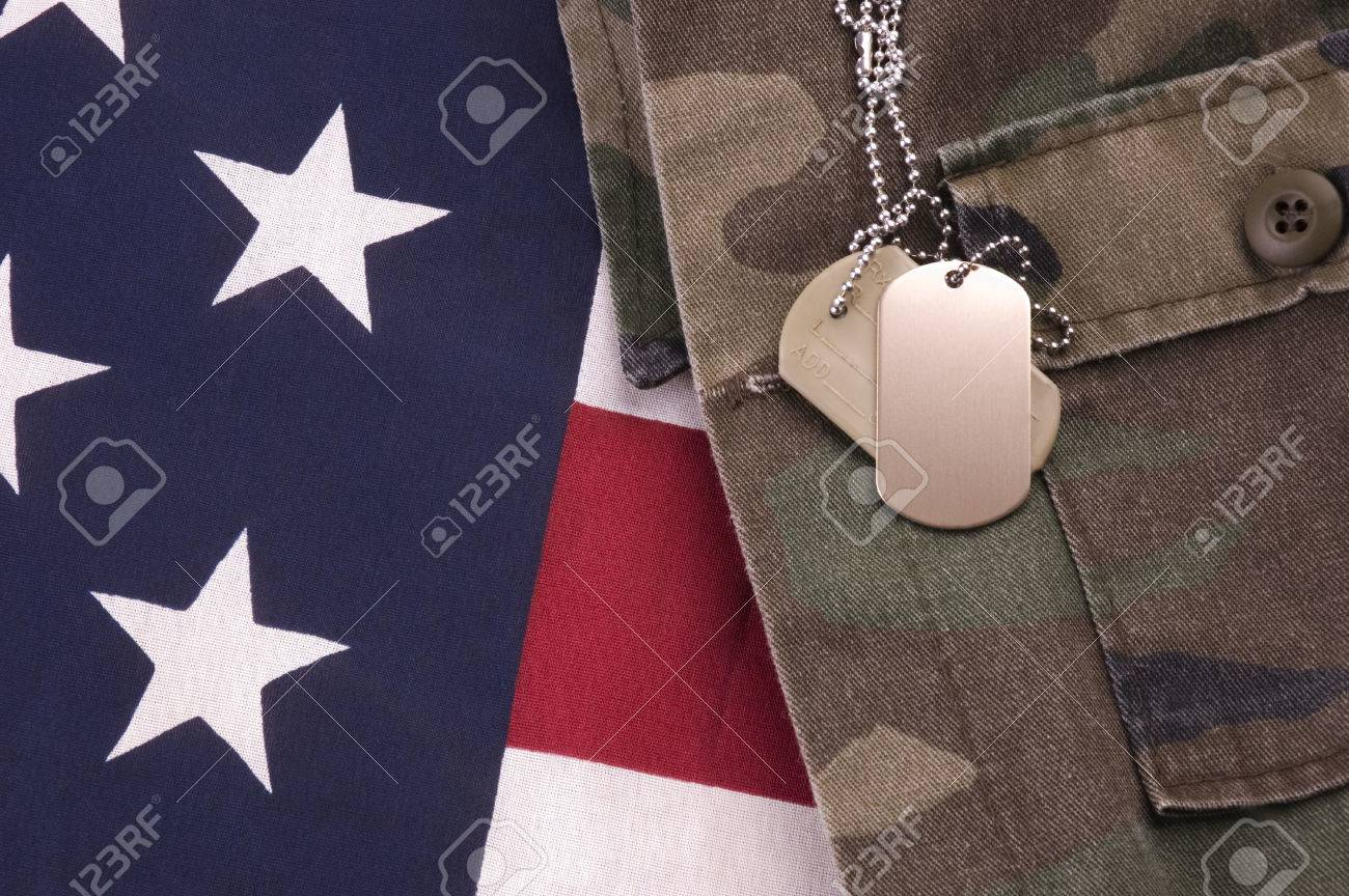 Military Dog Tags on American Flag and fatigues Stock Photo - 1397356