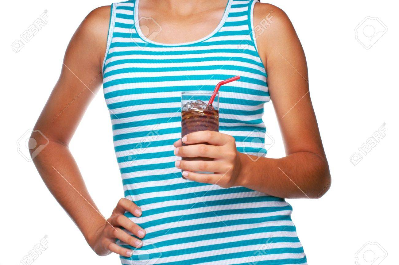 Girl Holding a Glass of Soda with one hand on her hip isolated over white Stock Photo - 3291260