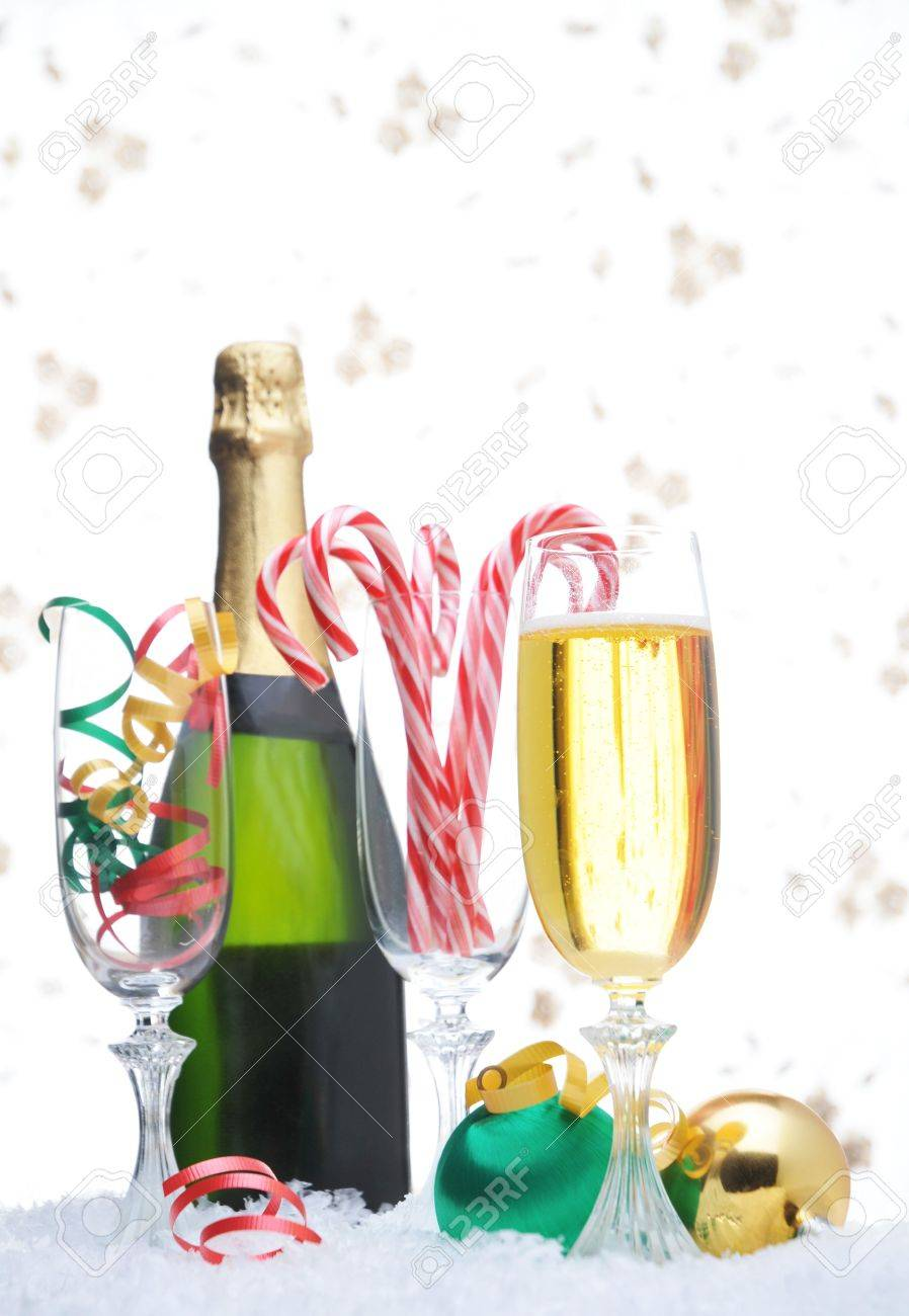 Wine bottle ornaments - Champagne Bottle And Glass With Candy Canes And Christmas Ornaments In Snow Stock Photo 3906743