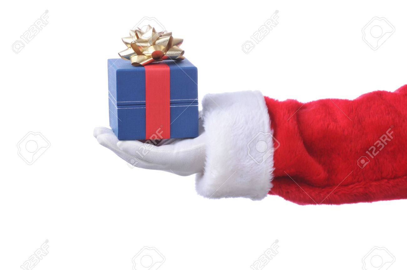 Santa Claus hand holding out a gift box isolated on white Stock Photo - 4006152