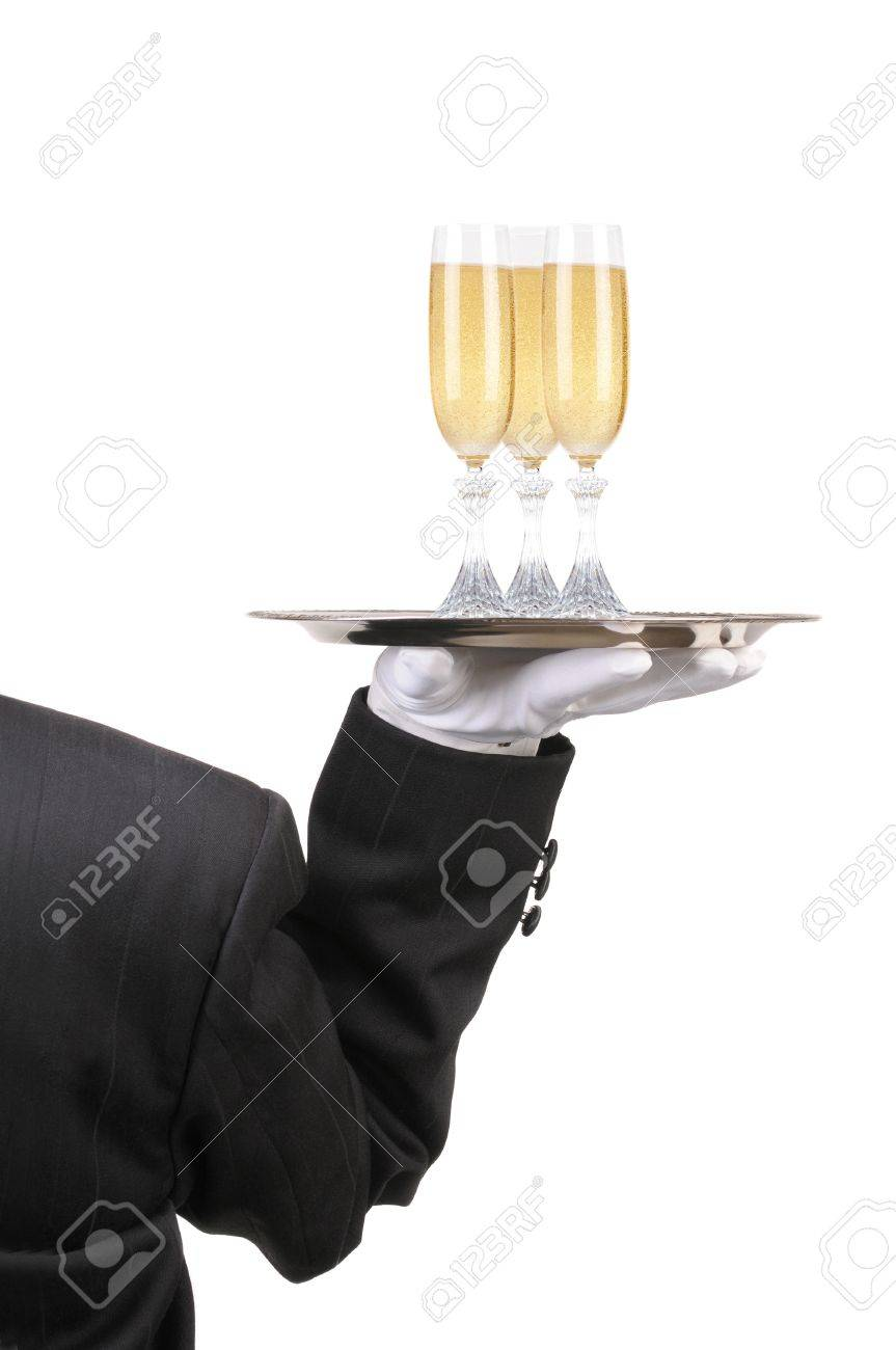 Butler in Tuxedo seen from behind with three champagne glasses on serving ray held at shoulder height vertical format over white Stock Photo - 6979776