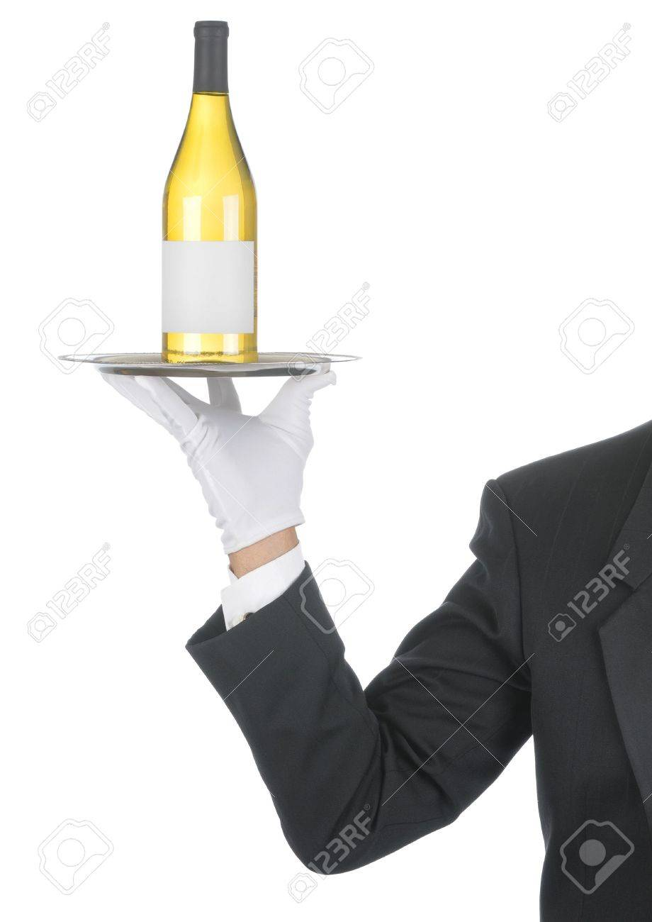 Butler wearing tuxedo and formal gloves holding a white wine bottle on a silver tray. Shoulder hand and arm only isolated on white vertical composition. Stock Photo - 7059056