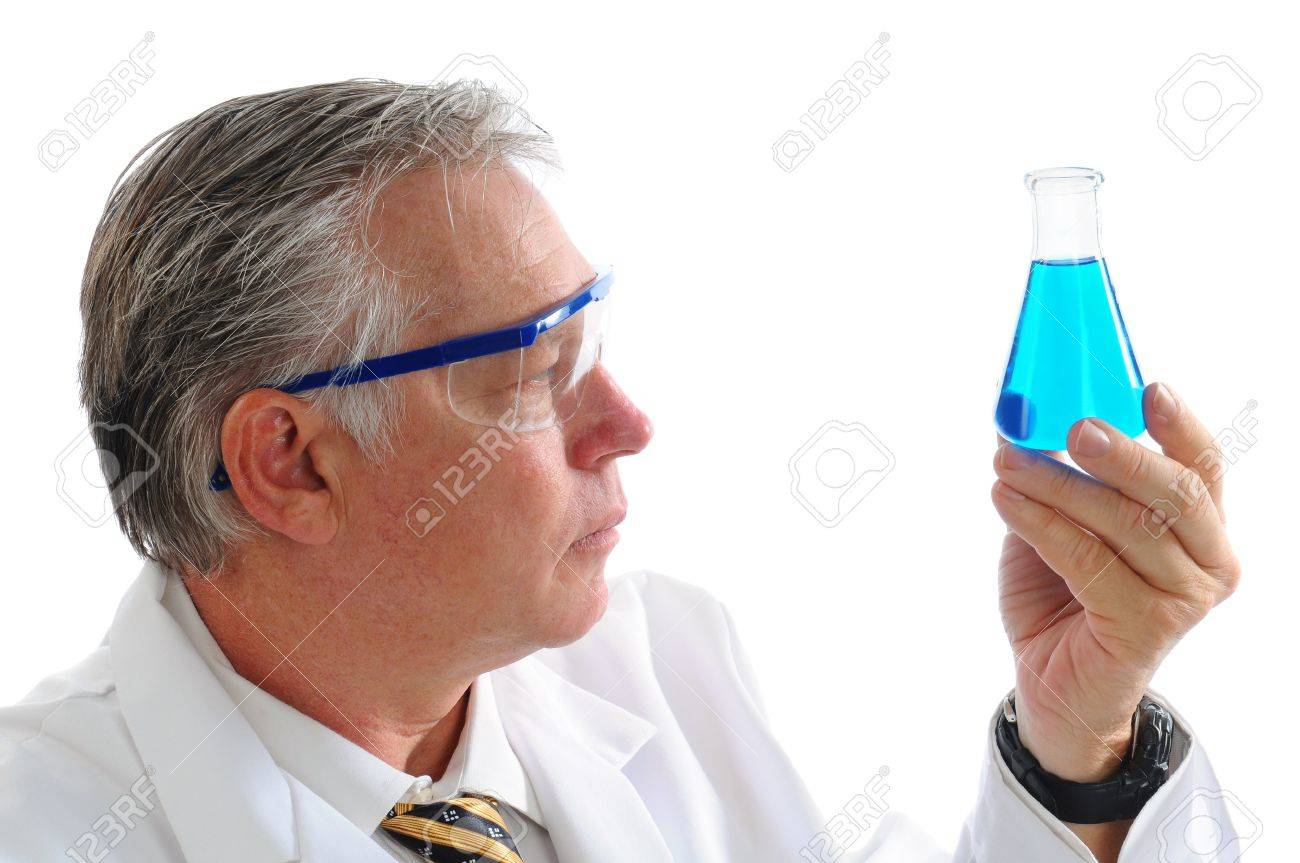 Profile shot of a middle aged scientist examining a blue liquid in a beaker isolated over white. Horizontal format. Stock Photo - 10043685
