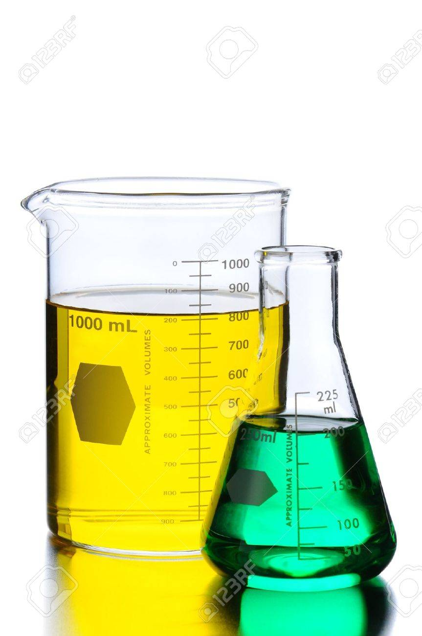 Closeup of Glass Two Beakers with Green and Yellow Liquids on a lab table with reflections. Vertical format isolated on white. - 10043687