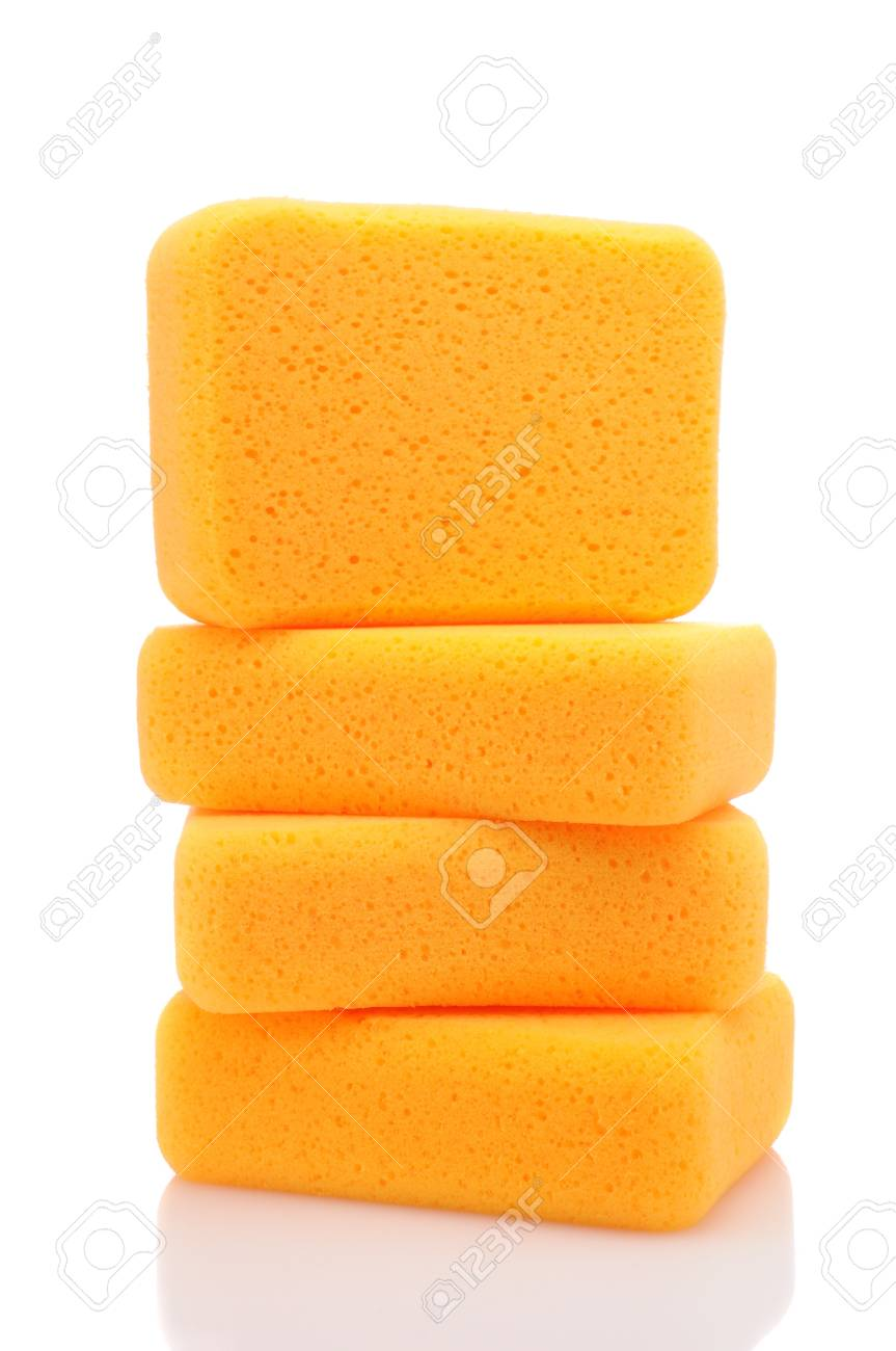 A stack of sponges over a white background with reflection. Stock Photo - 13132920