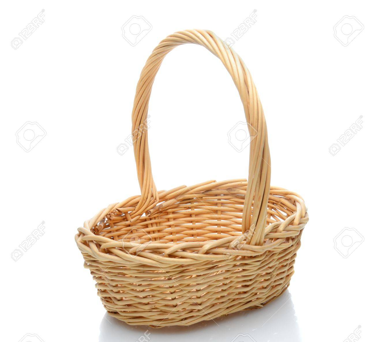 White wicker baskets with handle - Oval Wicker Basket With Handle Isolated On A White Background With Slight Reflection Stock Photo