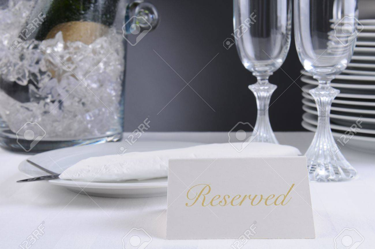 Closeup of a Reserved sign on a restaurant table that is set for an elegant occasion. Shallow depth of field. Stock Photo - 16242293