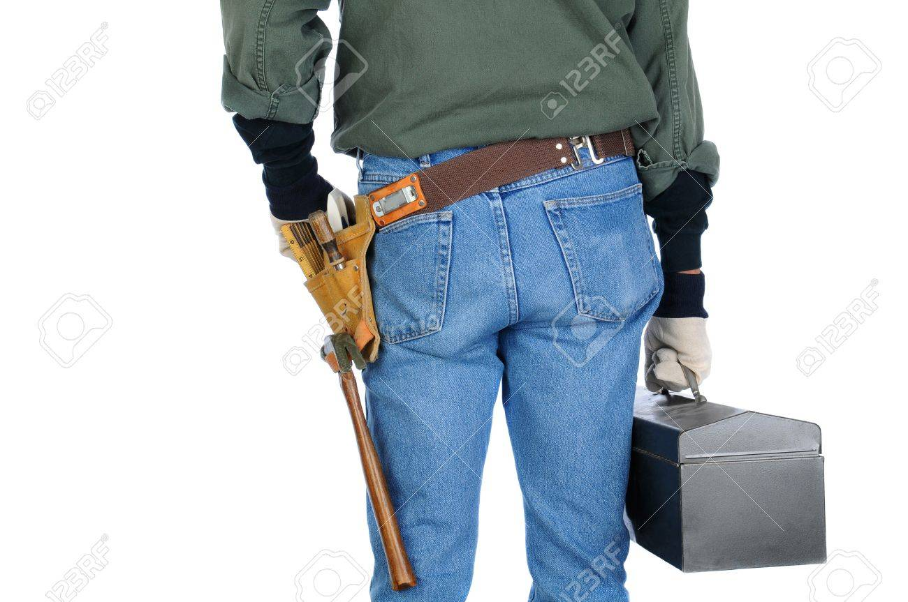 Closeup of a construction worker holding a tool box. Man is view from behind on a white background. Stock Photo - 18589875