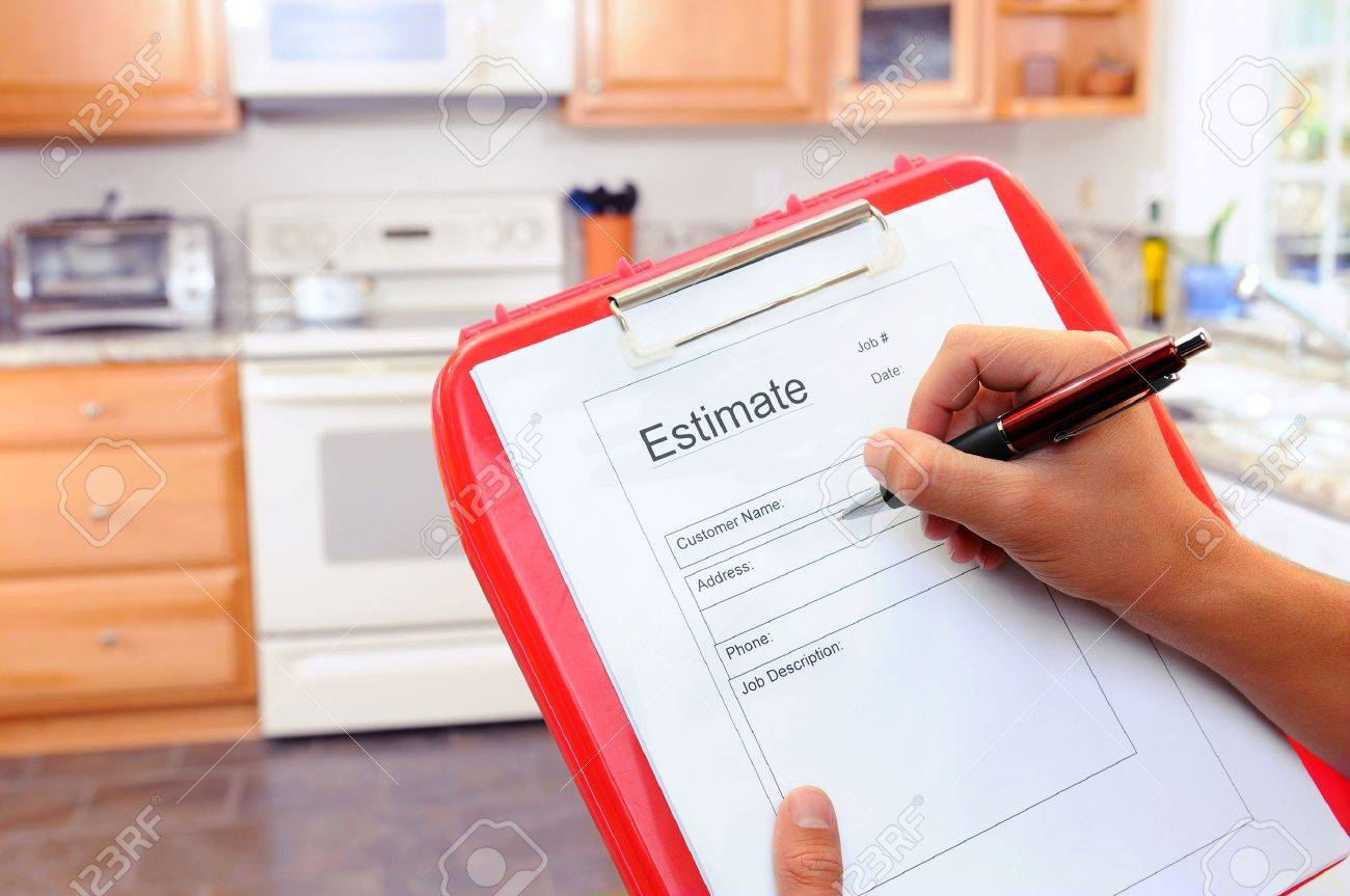 18942884 Closeup of a contractors clipboard as he writes up an estimate for a kitchen remodel Shallow depth o Stock Photo