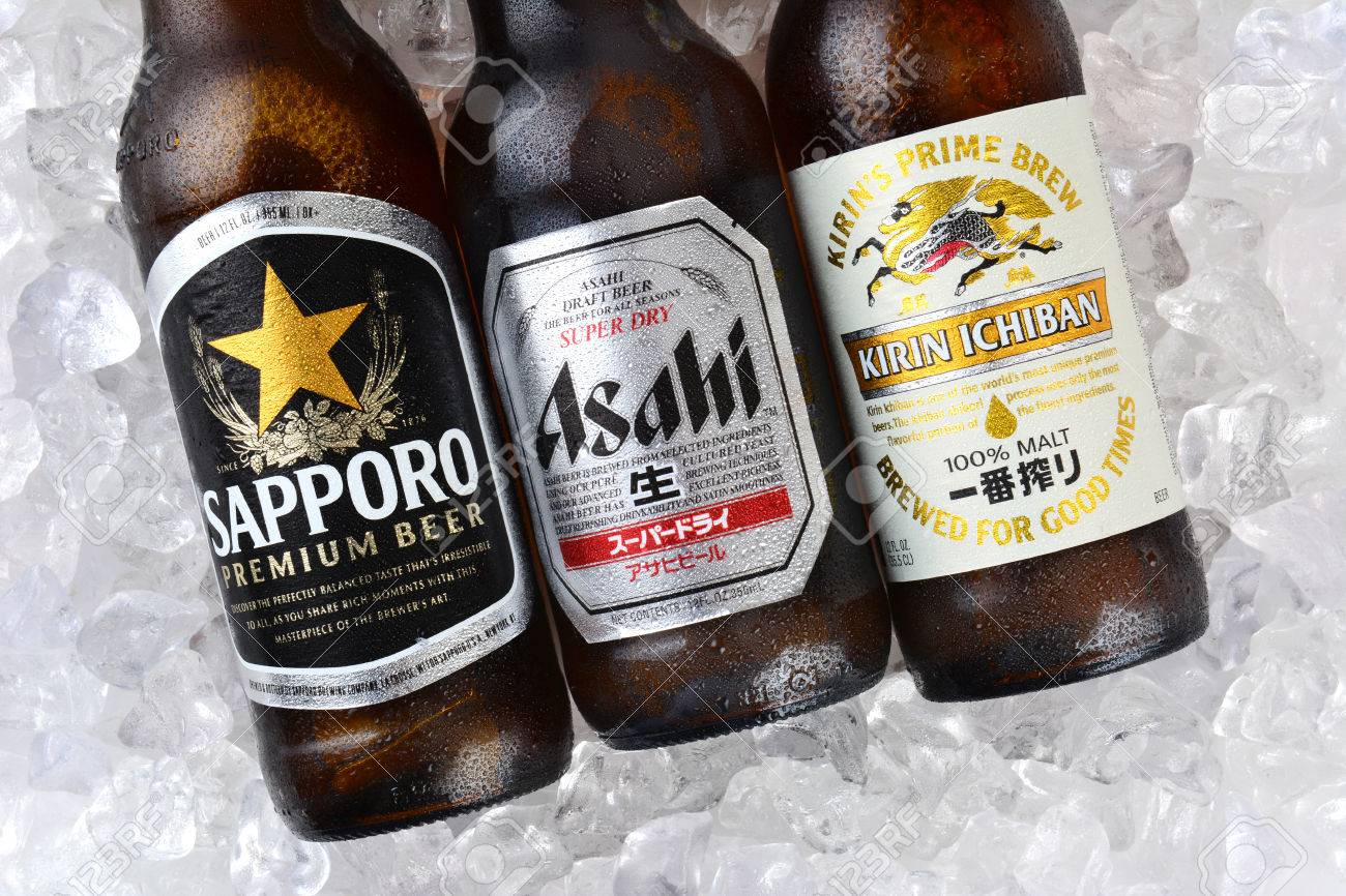 IRVINE, CA - JANUARY 11, 2015: Three bottles of Japanese beers on a bed of ice. Sapporo, Asahi and Kirin Ichiban are three of the most popular Japanese beers imported into the USA - 35729374