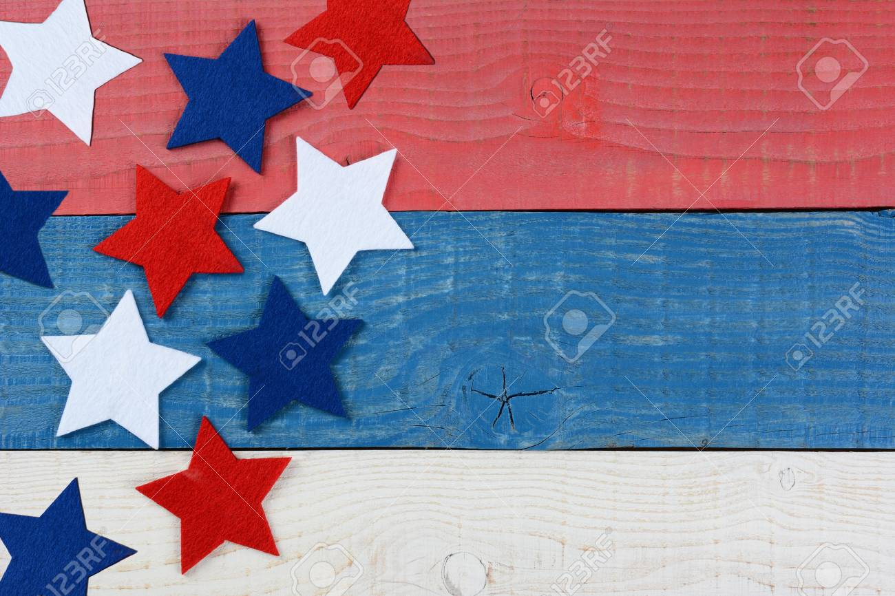 High angle shot of red white and blue stars on a patriotic picnic table. The wood table is painted red, white and blue. Perfect for Memorial Day or 4th of July themes, with copyspace. - 35922726