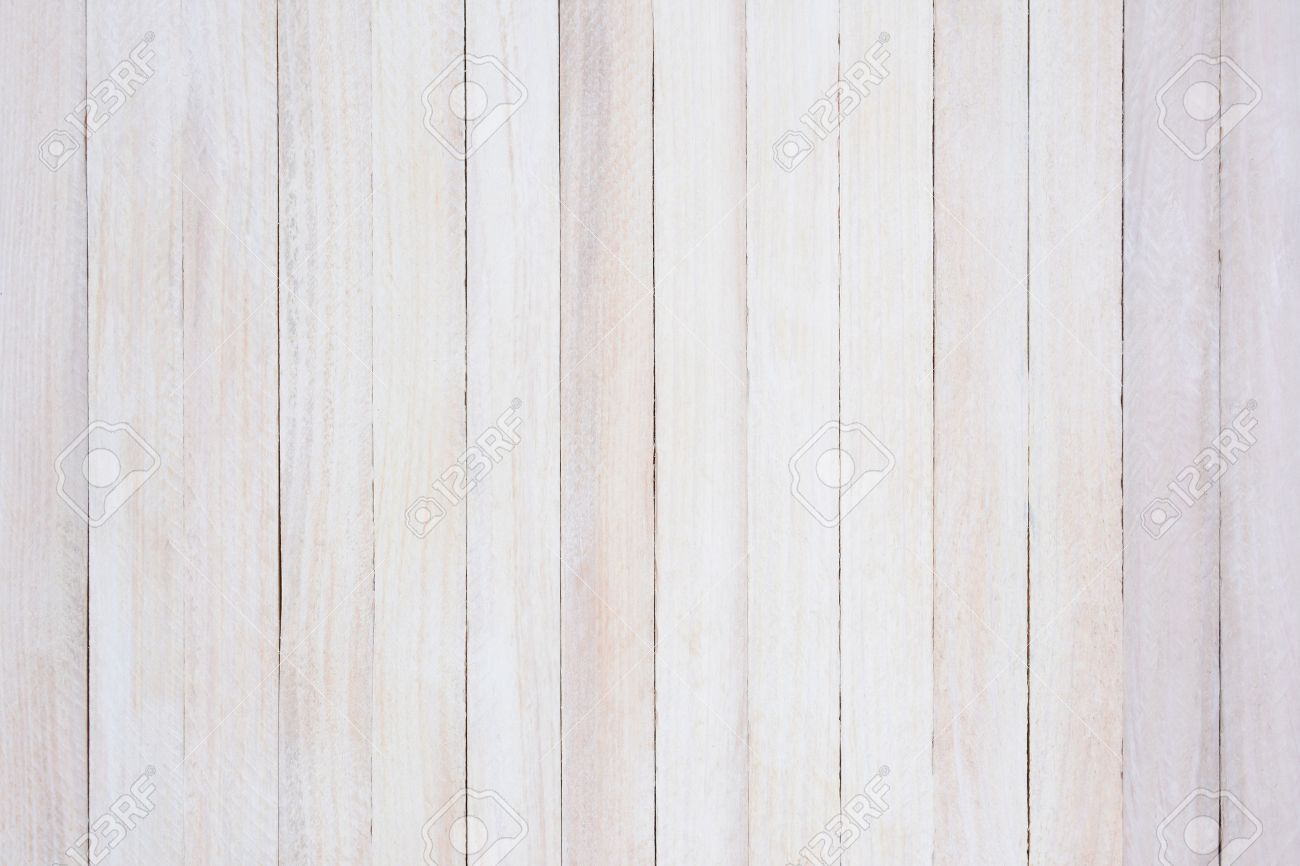closeup of a rustic whitewashed wood background the boards are straight up and dow
