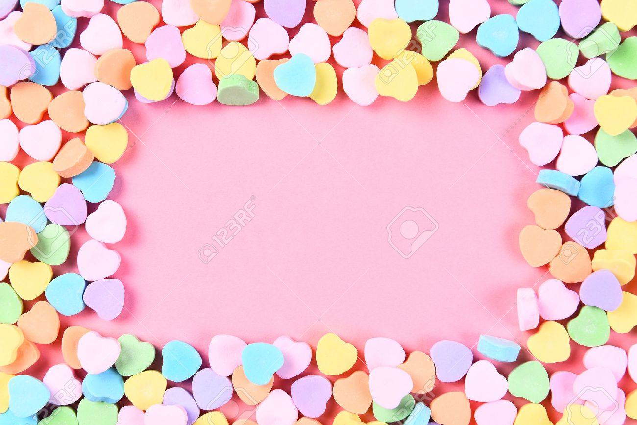 High Angle Shot Of Valentines Day Candy Hearts On A Pink Background
