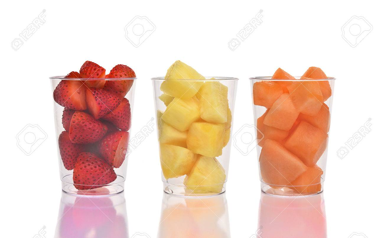 Three fresh fruit cups on white with reflection. Strawberries, Pineapple and Cantaloupe in plastic cups. - 53558408