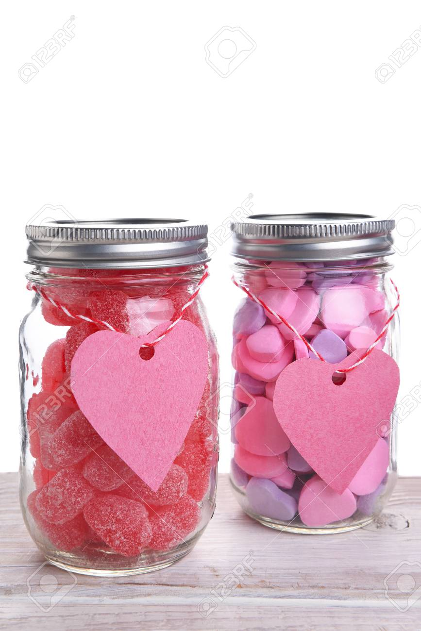 Two Canning Jars Filled With Valentines Day Candy Hearts Vertical