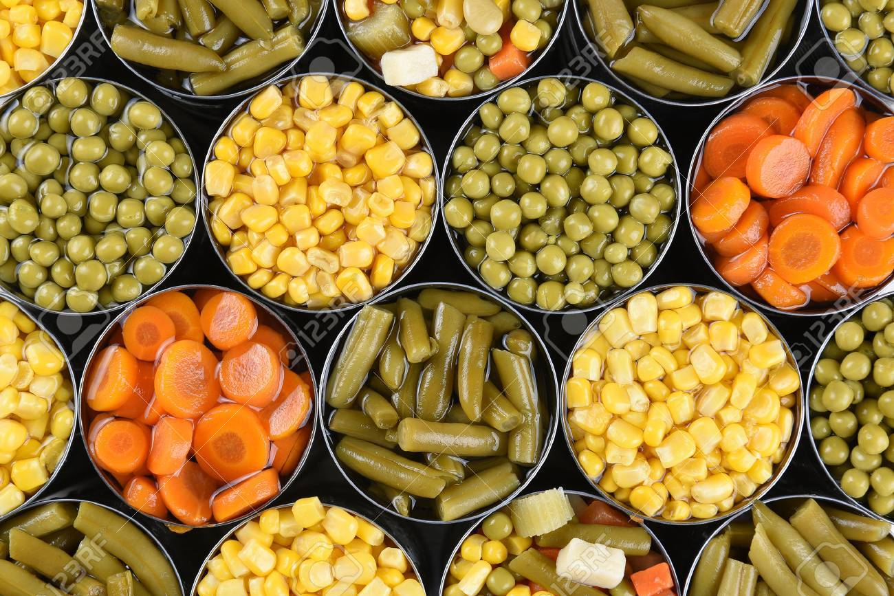 Group of open canned vegetables shot from a high angle. Assorted veggies carrots, corn, green beans, peas and mixed vegetables. - 68839169