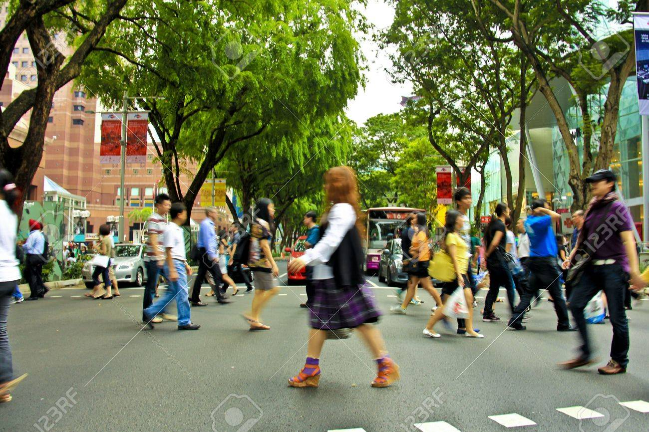 The most popular and busiest road in Singapore, Orchard Road during rush hour Stock Photo - 9880530