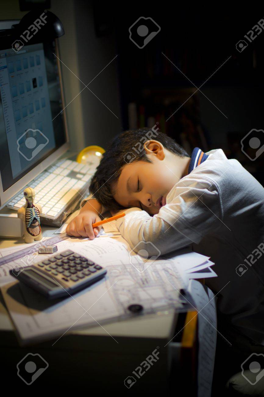 A boy fell asleep tired during his study Stock Photo - 9948201