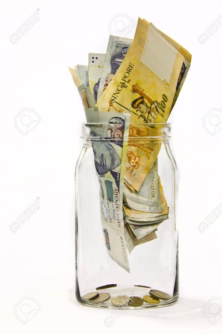Singapore money in a jar symbol of savings money isolated in singapore money in a jar symbol of savings money isolated in white background stock biocorpaavc
