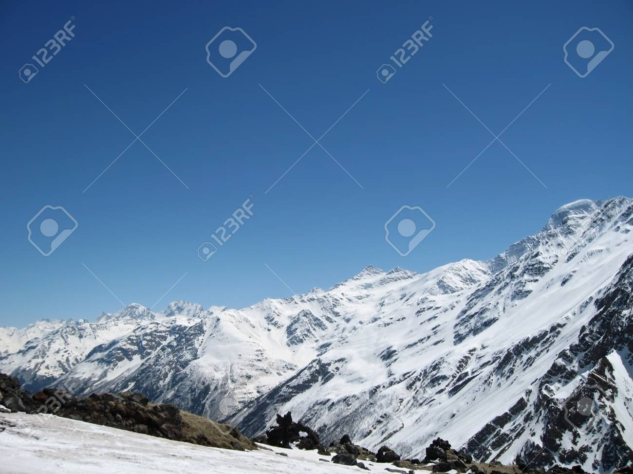 Caucasus mountains under the snow and clear sky Stock Photo - 11473927