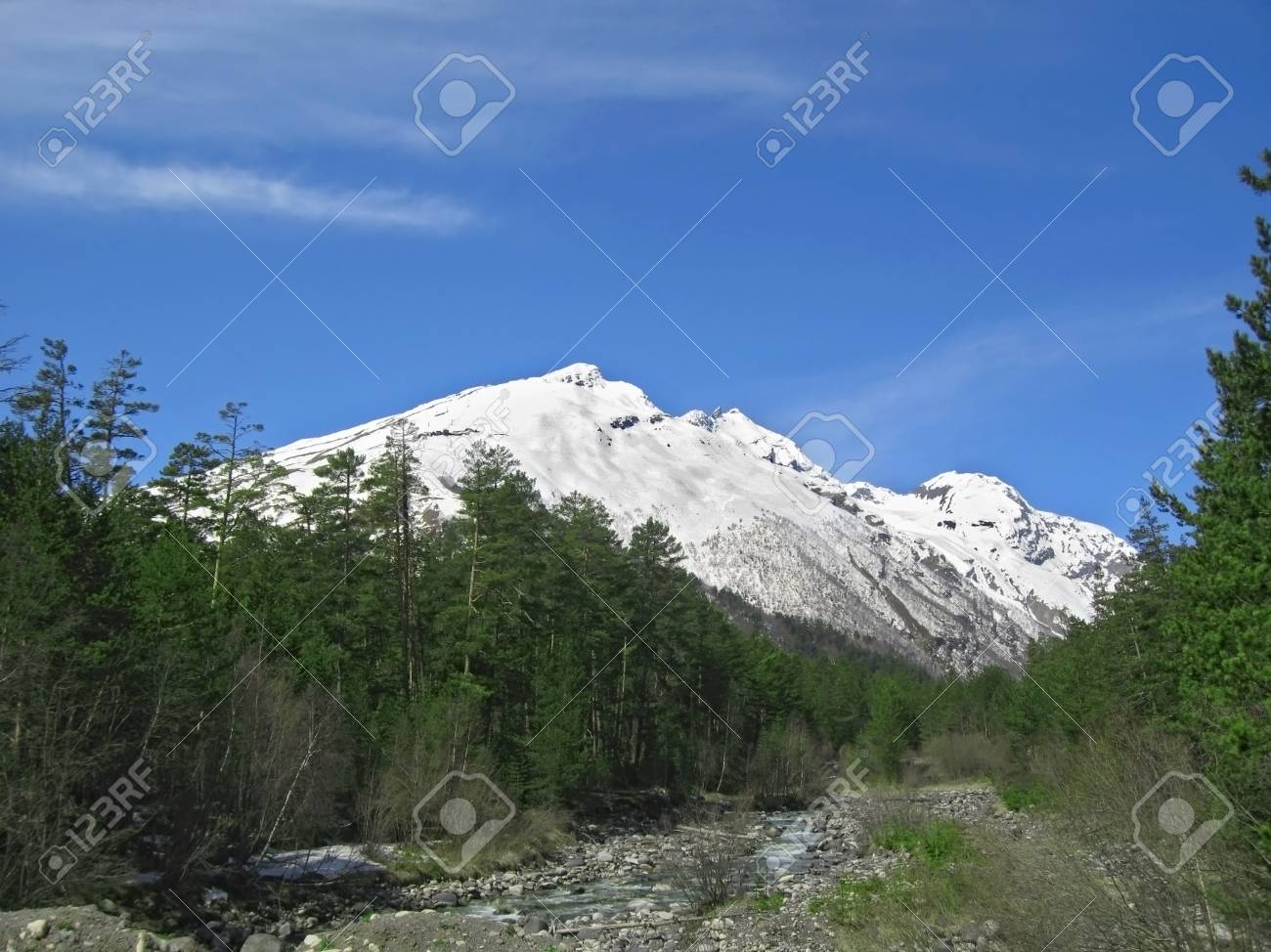 Caucasus mountains under the snow and cloudly sky Stock Photo - 11473899